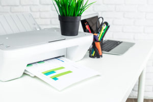 Home Printing Report from Quocirca features an image of a desktop home printer in a home office