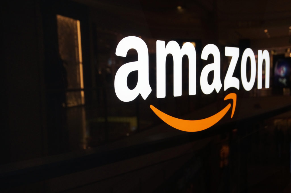 Quocirca's executive briefing on the Amazon effect profiles amazon's logo to represent the analysis of their services and the disruption it is bringing to the print industry